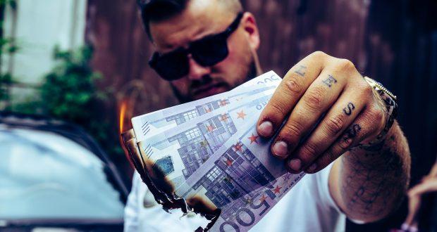 Man burning money