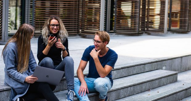 Three students on steps